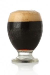Fresh beer glass over white background